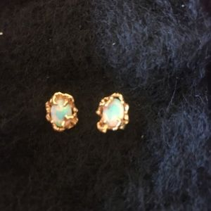 14k gold and opal stud earrings.